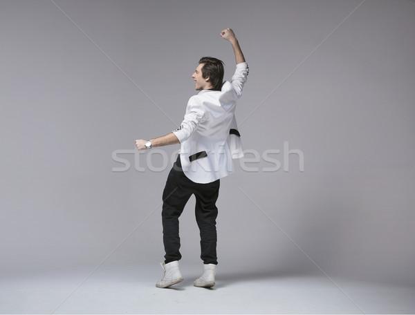 Handsome young guy in euphoria Stock photo © konradbak