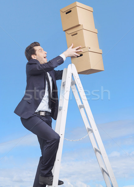 Young manager loosing the boxes Stock photo © konradbak