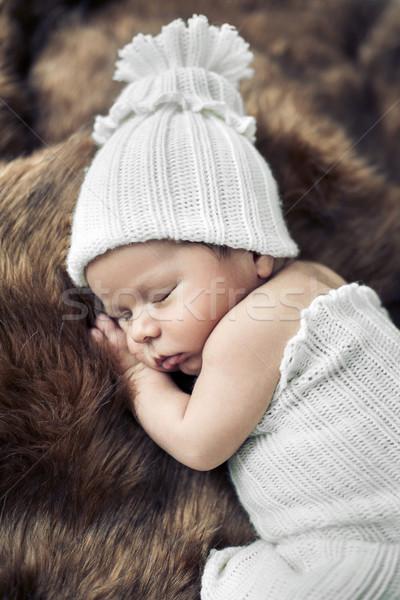 Cute baby sleeping on the fur Stock photo © konradbak