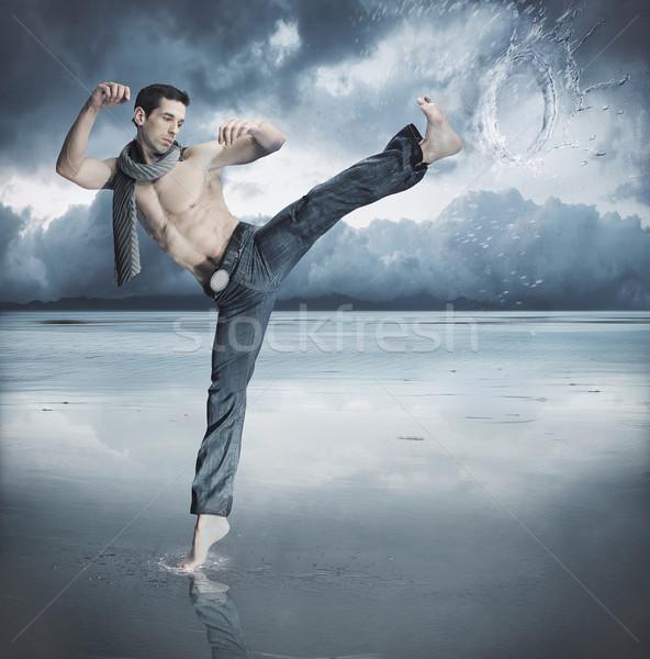 Taekwondo fighter training , over winter background Stock photo © konradbak