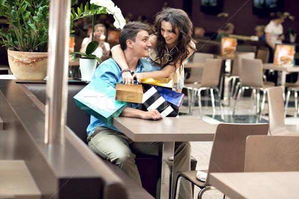 Young happy couple at the shopping center Stock photo © konradbak
