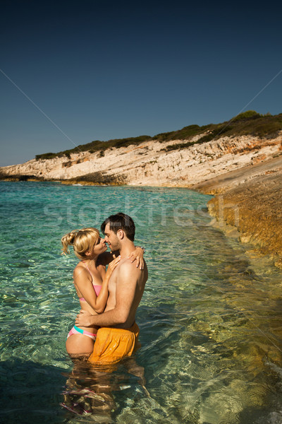 Couple on a tropical beach Stock photo © konradbak