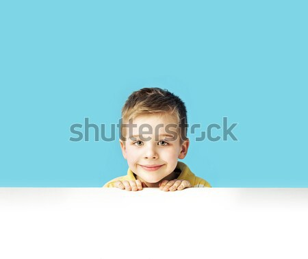 Little man playing hide and seek Stock photo © konradbak