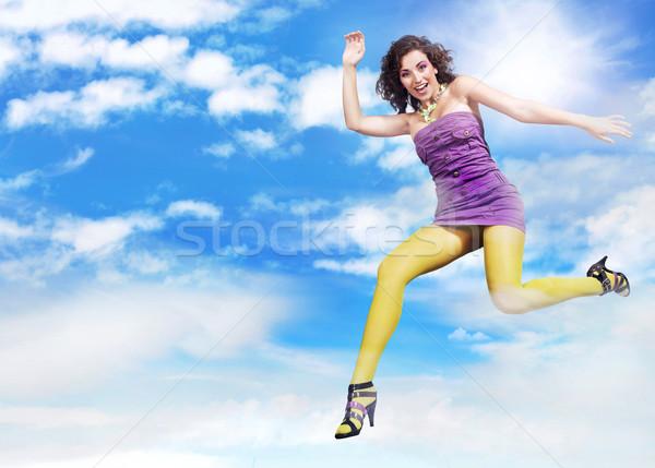 Jeunes brunette beauté sautant ciel paysage Photo stock © konradbak