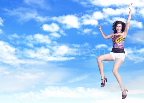Young brunette beauty jumping  Stock photo © konradbak