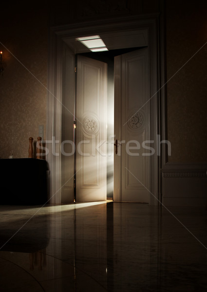 Mysterious rays of light behind door Stock photo © konradbak