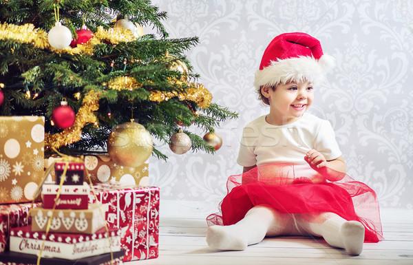 Portrait of a little girl dressed up a santa Stock photo © konradbak