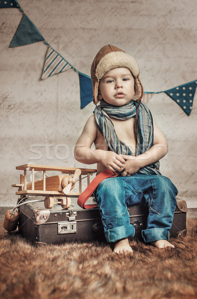 Small, cute pilot with a wooden plane Stock photo © konradbak