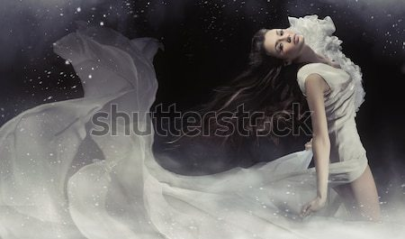 Beautiful brunette lady in white dress Stock photo © konradbak
