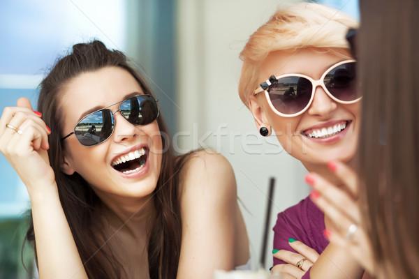 Smiling women Stock photo © konradbak