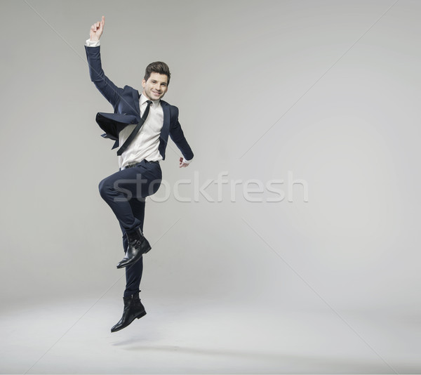 Cheerful businessman achieving the succes Stock photo © konradbak
