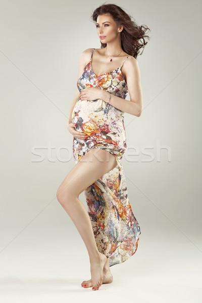 Fashionable pregnant woman wearing flowered dress Stock photo © konradbak