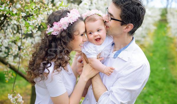 Genitori bacio amato bambino baby Foto d'archivio © konradbak