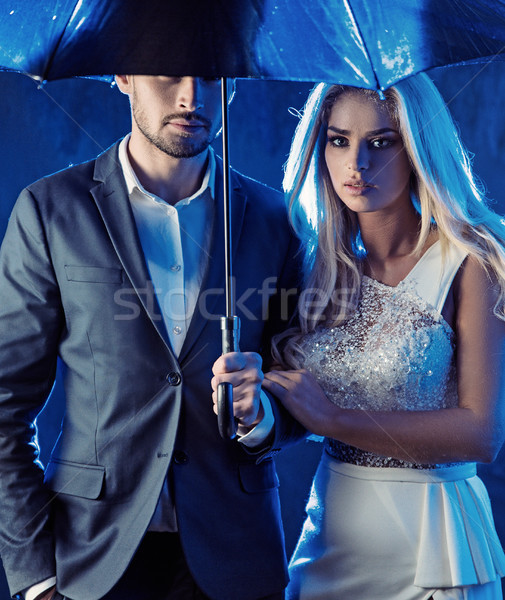 Amorous couple posing on a rainy bacground Stock photo © konradbak