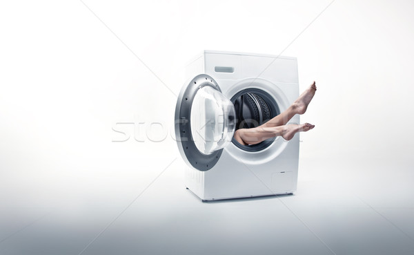 Conceptual photo of a woman absorbed by household duties Stock photo © konradbak
