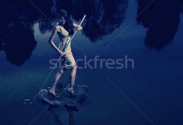 Fine art image of a woman sailing a leaf Stock photo © konradbak