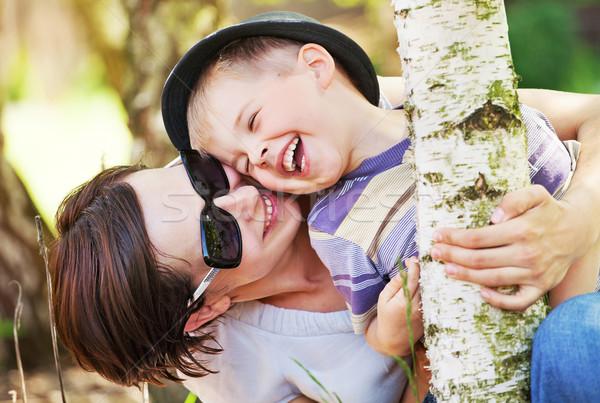 смеясь небольшой мальчика матери довольно цветок Сток-фото © konradbak