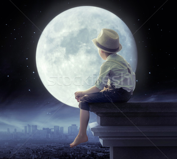 Little boy looking a the city in the night Stock photo © konradbak