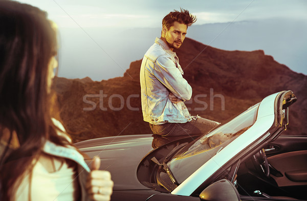 Young couple standing next to the convertible Stock photo © konradbak
