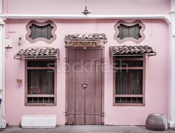 Ancient, pink building with a wooden door Stock photo © konradbak