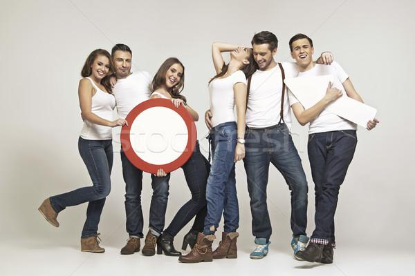Group of laughing friends in fancy pose Stock photo © konradbak