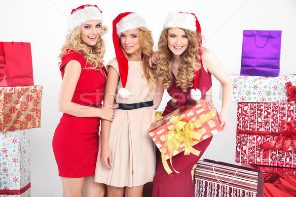 Three alluring women wearing Christmas hats Stock photo © konradbak