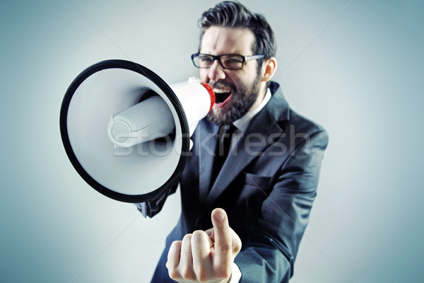 Agressive businessman yelling over the megaphone Stock photo © konradbak