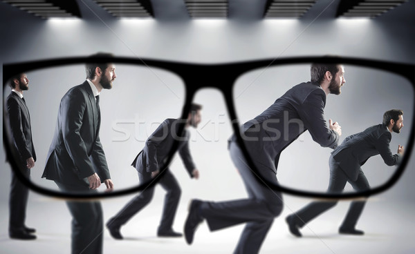 Focus on the numerous businessmen Stock photo © konradbak
