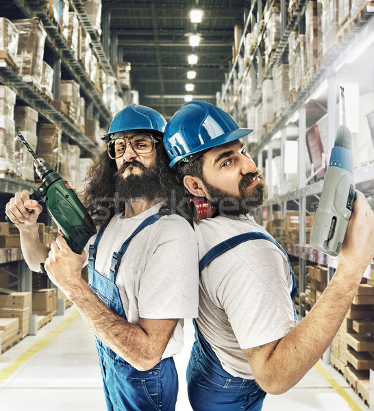 Portrait of two builders in a storehouse Stock photo © konradbak