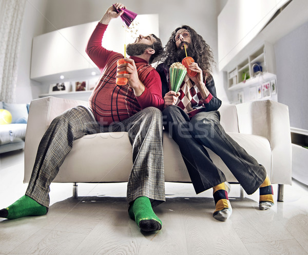 Funny portrait of two friends watching tv Stock photo © konradbak