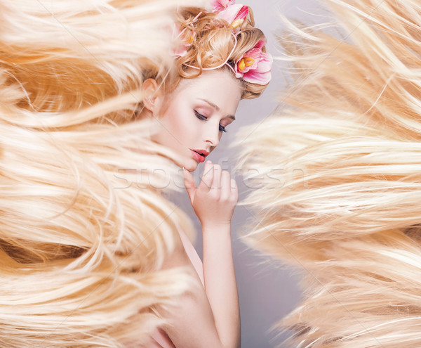 Conceptual portrait of a delicate lady with a fluffy coiffure Stock photo © konradbak