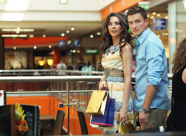 Young couple walking at shopping passage Stock photo © konradbak