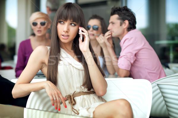 Beautiful young lady calling Stock photo © konradbak
