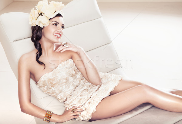 Sexy brunette lady with flower hat Stock photo © konradbak