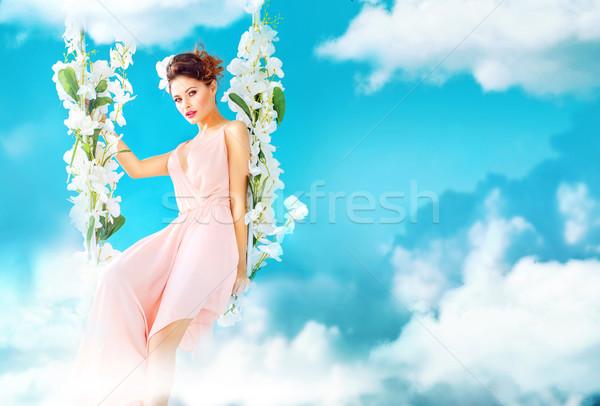 Káprázatos hölgy édenkert nő felhők fű Stock fotó © konradbak