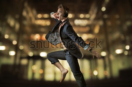 Stylish man with night town over the background Stock photo © konradbak