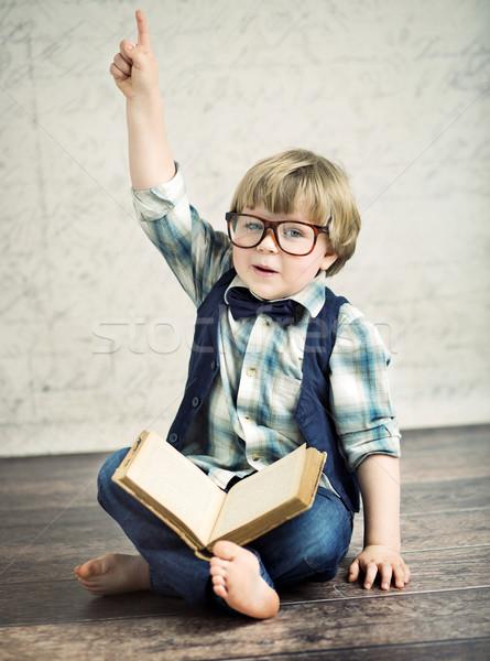 Clever boy reading a novel Stock photo © konradbak