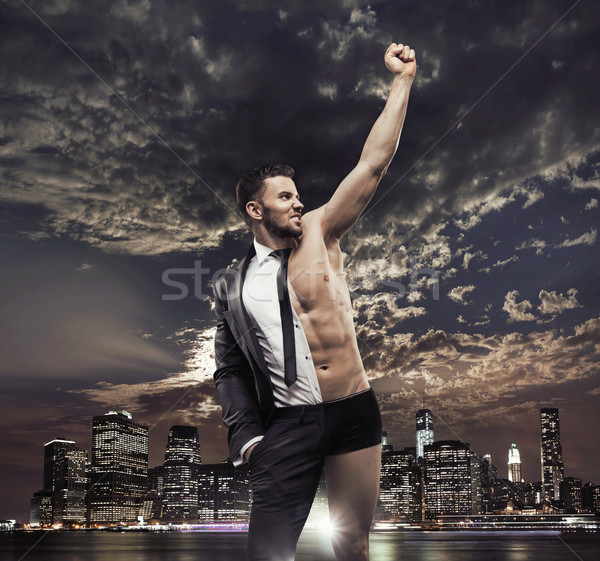 Succesful businessman over the city background Stock photo © konradbak