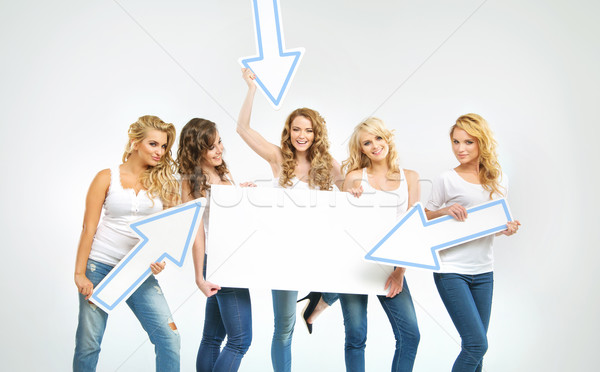 Gorgeous women promoting the sale Stock photo © konradbak