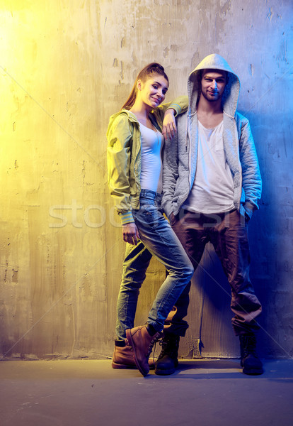 Portrait of two talented hip-hop dancers on a concrete backgroun Stock photo © konradbak