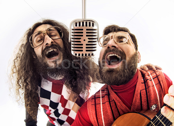 Two nerdy guys singing together Stock photo © konradbak