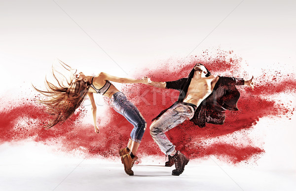 Talented young dancers sprinkling red dust Stock photo © konradbak