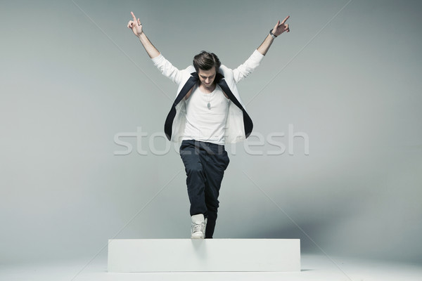 Stylish and handsome man in triumph pose Stock photo © konradbak
