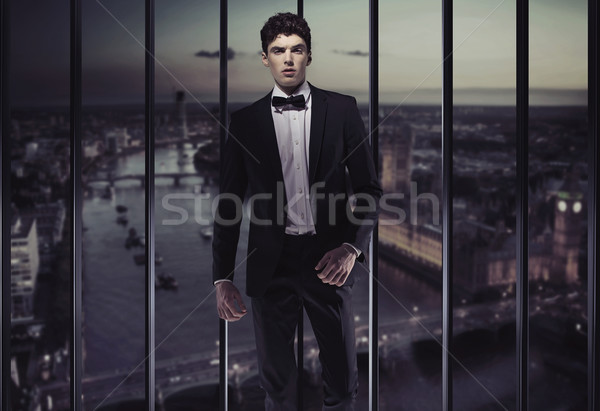 Serious young man on the top of the building Stock photo © konradbak