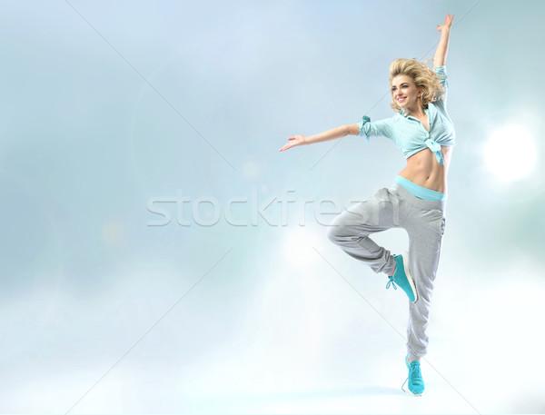 Shapely dancer practicing trhe choreography Stock photo © konradbak
