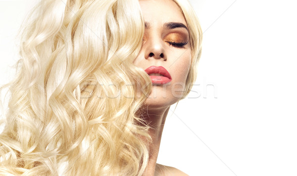 Portrait of the lady with curly and bushy coiffure Stock photo © konradbak