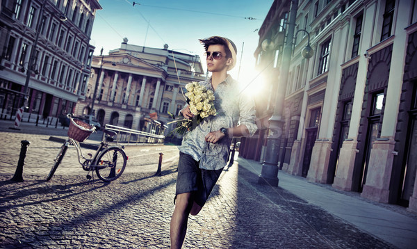 Handsome man looking for his girlfriend Stock photo © konradbak