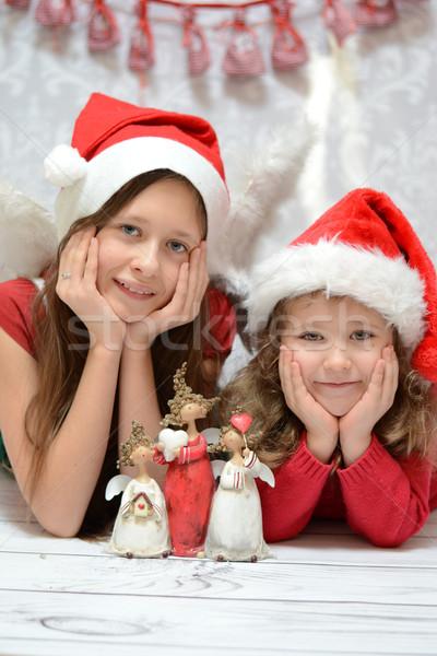 Kettő örvend nővérek mikulás piros boldog Stock fotó © konradbak
