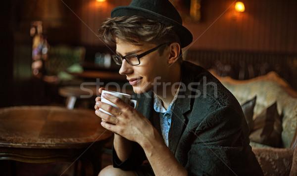 örvend fickó iszik kávé elegáns arc Stock fotó © konradbak