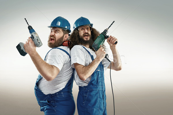 Funny portrait of two craftsmen Stock photo © konradbak
